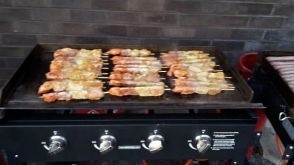 gas-griddle-cooking-food kebabs